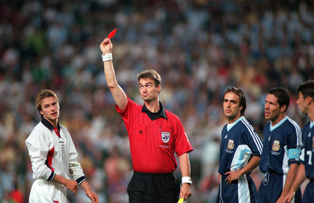 World Cup 1998 Finals, St. Etienne, France. 30th June, 1998.  England 2 v Argentina 2 (Argentina win 4-3 on penalties). Referee Kim Milton Mielsen sends off England's David Beckham for kicking out at Diego Simeone.